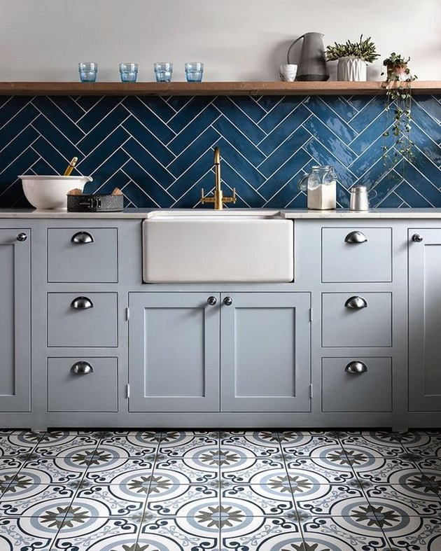 ceramic kitchen floor tile with blue backsplash and open shelving