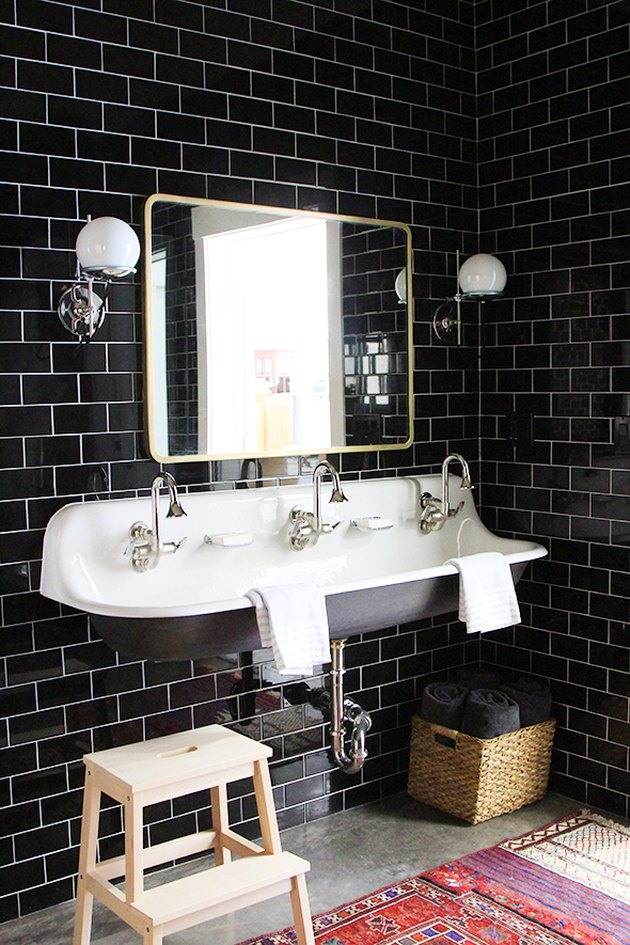 industrial bohemian bathroom with trough sink
