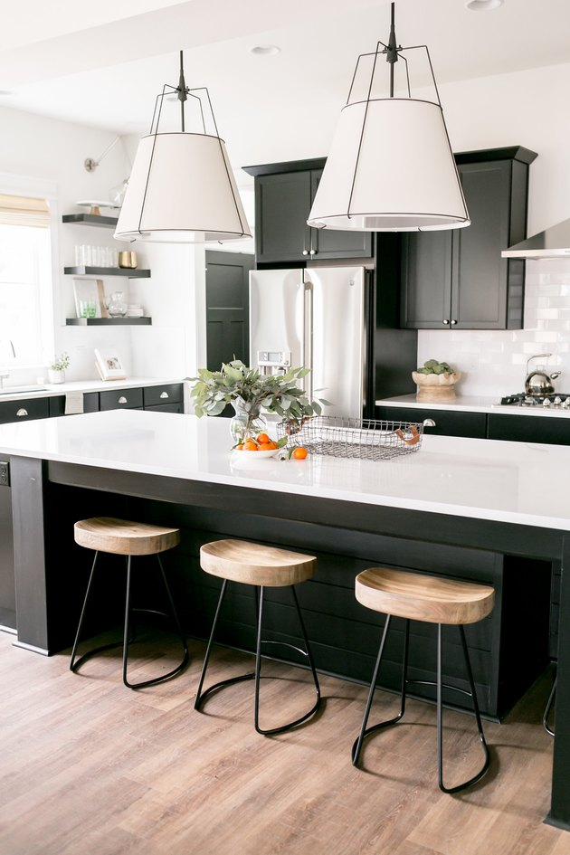 pendant kitchen ceiling light over island with black cabinets