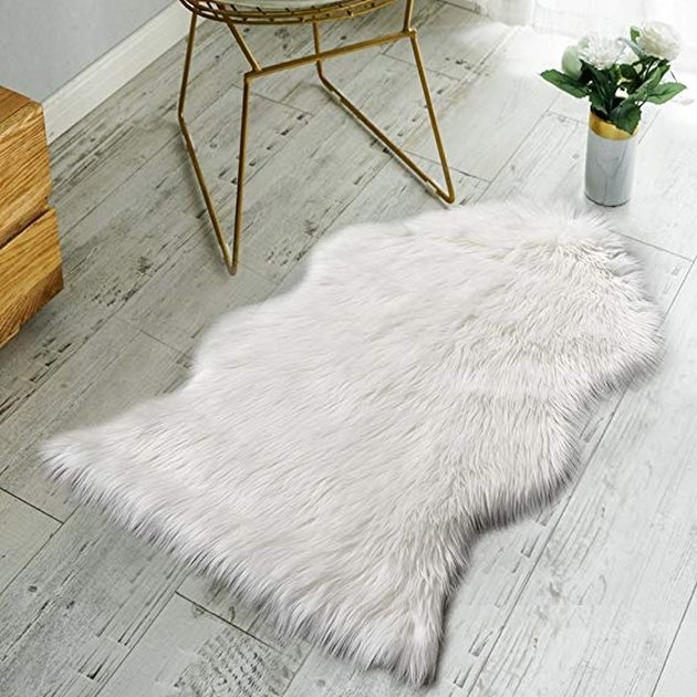 White faux fur animal rug