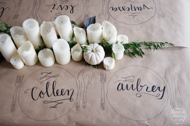 Hand lettered Thanksgiving tablecloth place settings on kraft paper