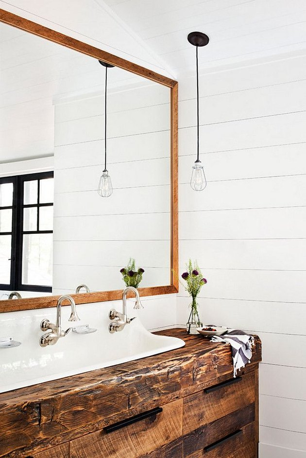 modern farmhouse bathroom with wood countertop vanity and trough sink