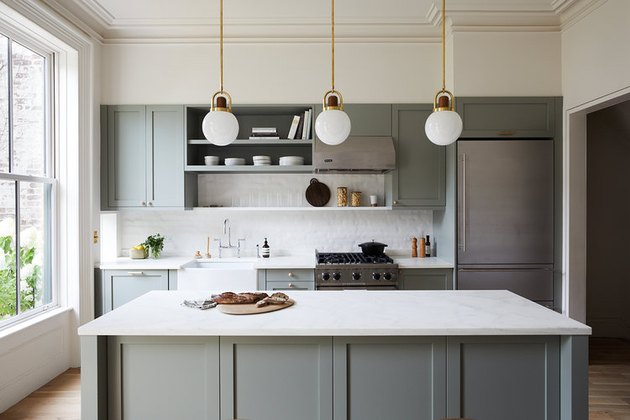 kitchen island idea with white countertop and three pendant lights overhead