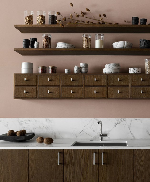 pink and brown kitchen color scheme with open shelving and wood cabinets