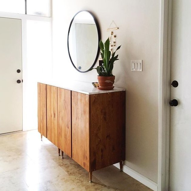 console table in entryway with top wrapped in marble plywood
