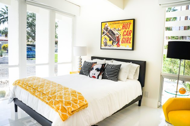 Bedroom with white, black, and yellow colors