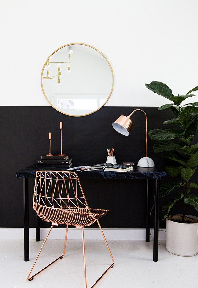 small home office with black color blocking and rose gold wire frame chair