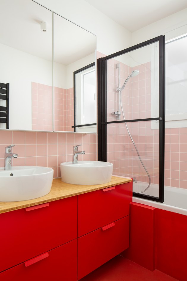 pink and red basement bathroom idea with window