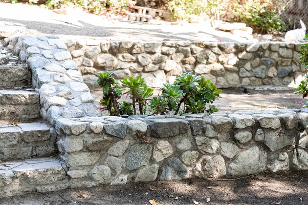 a stone retaining wall with stone steps