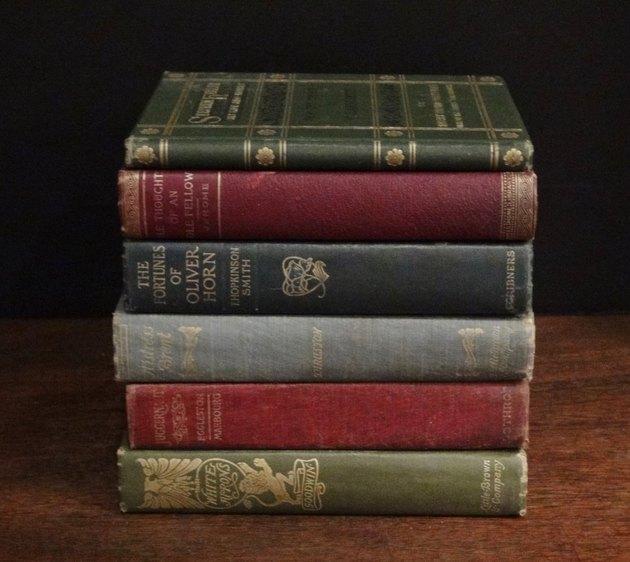 Stack of 6 Antique Books, $55