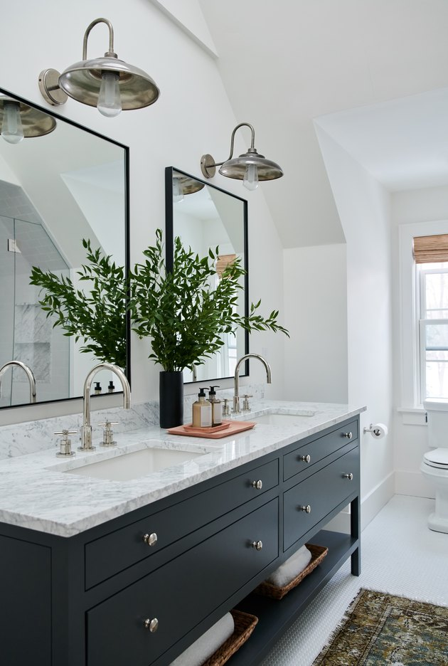 double vanity with undermount bathroom sinks and marble countertop and black vanity