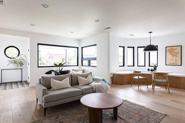 white room ideas with gray couch and dining banquette