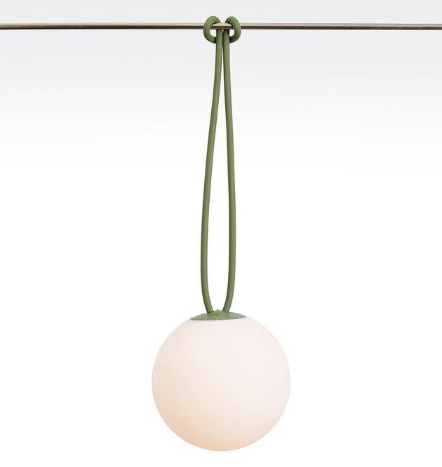 White globe light hanging from green rope