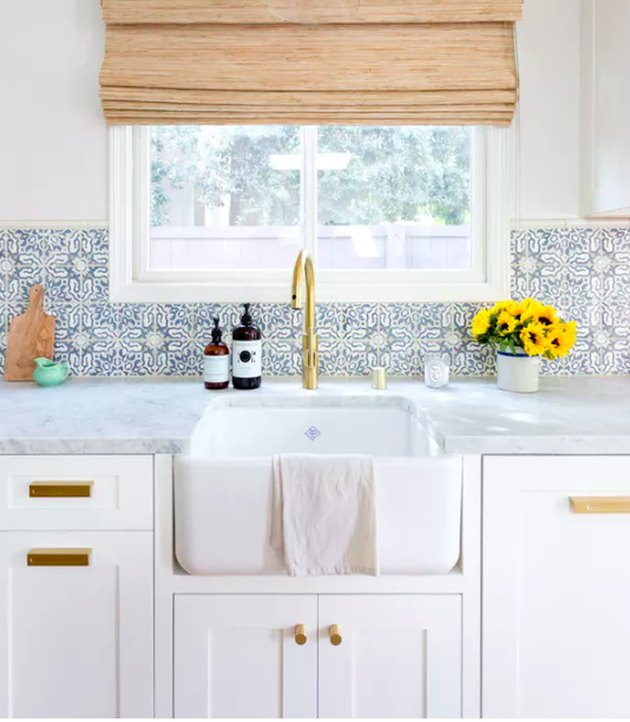 moorish tile backsplash in kitchen with farmhouse sink and Roman shade