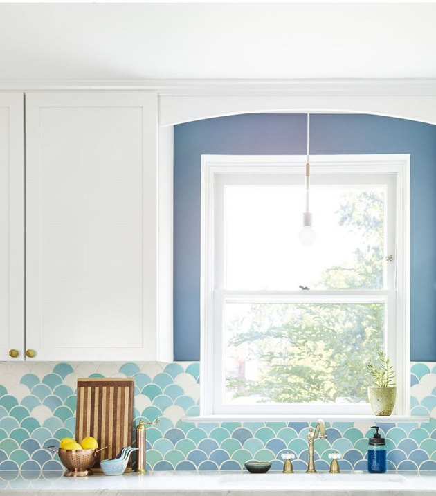 moroccan fish scale tile backsplash in modern kitchen with white cabinets