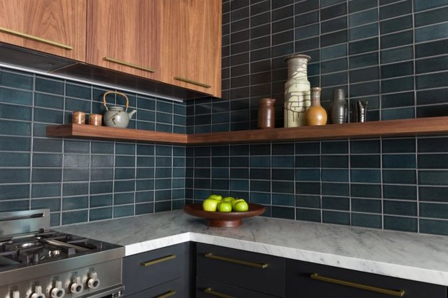 dark blue-green fire clay tile backsplash in modern kitchen