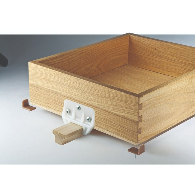 Wooden drawer glide.