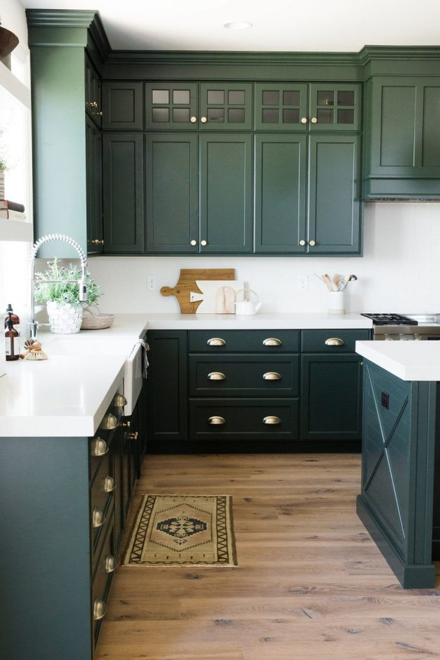 modern kitchen with green cabinets
