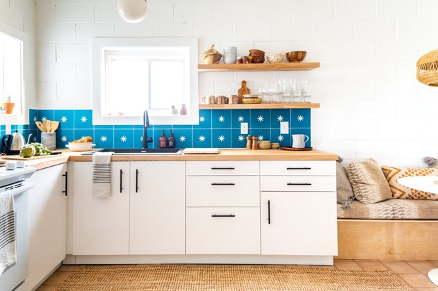 Blue and white star backsplash tile in white and wood kitchen