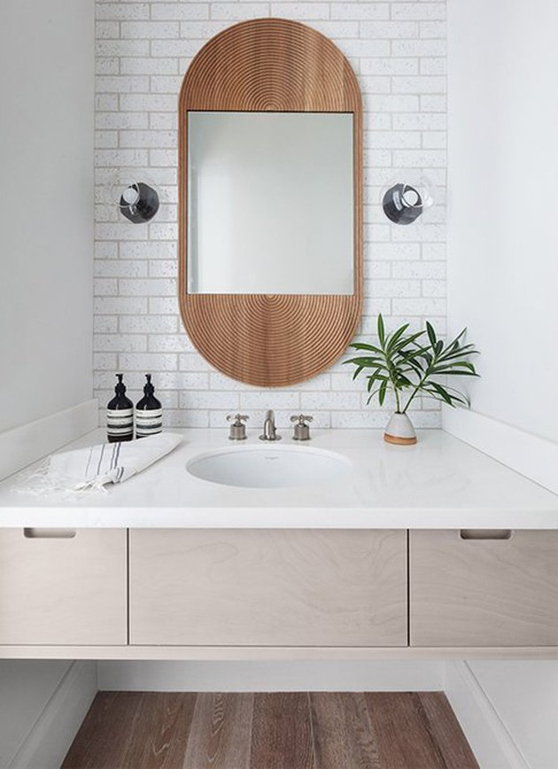 white boho space with undermount bathroom sink and floating vanity and subway tile backsplash