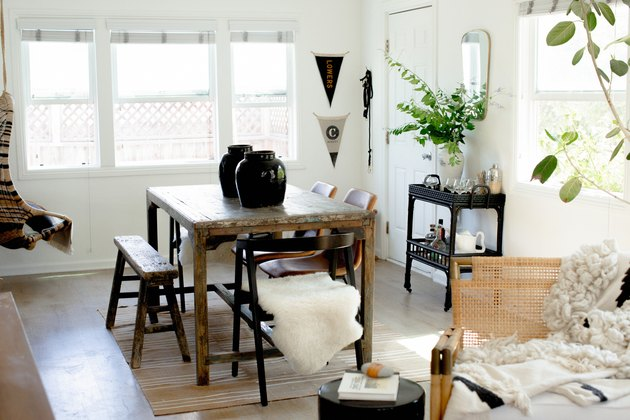 Vintage and modern dining room with black and wood accents