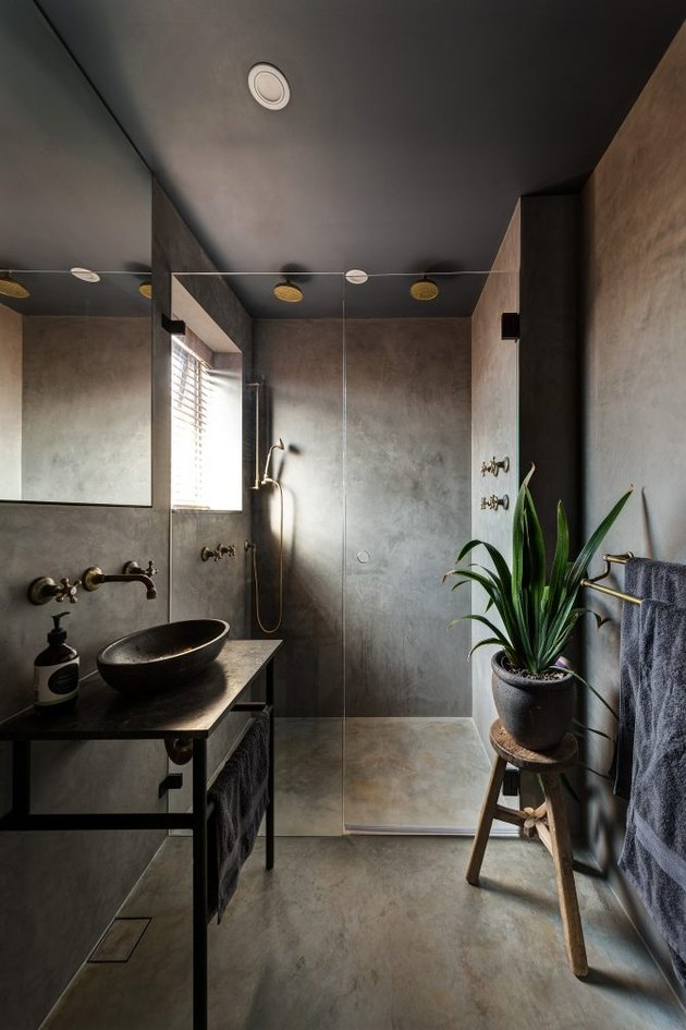 concrete bathroom with aged bronze shower bathroom fittings