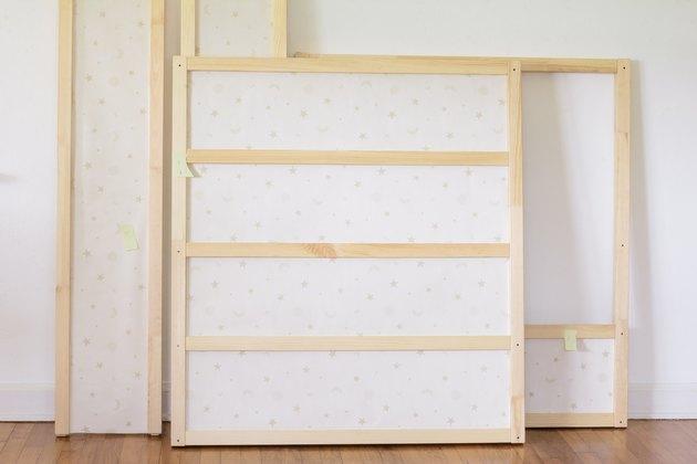KURA bed panels covered in wallpaper