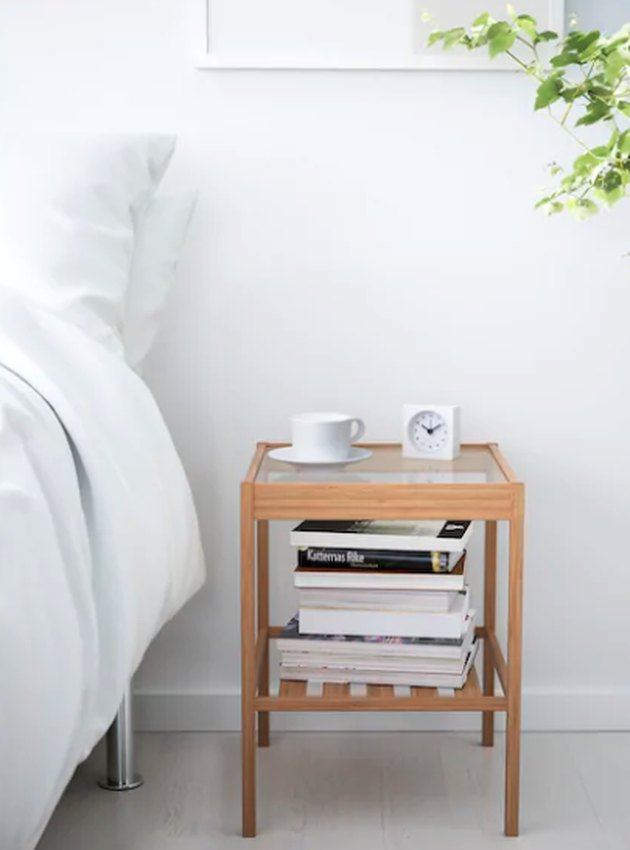 bedside table near bed and plants