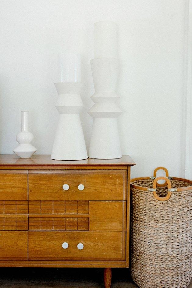 Ceramic pieces on a vintage dresser.