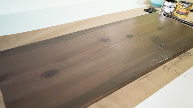 Blending gray and brown wood stain for faux weathered wood finish.