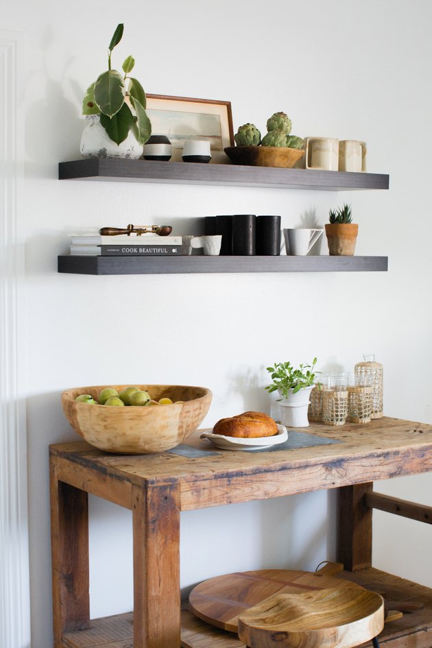 The butcher block table with floating shelves above.
