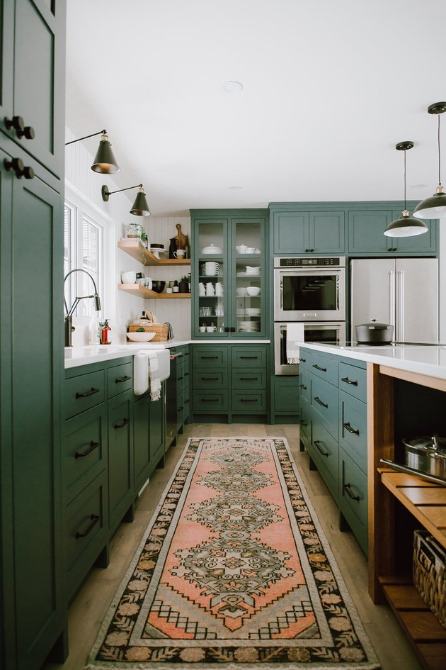 traditional kitchen lighting in green space with runner on floor