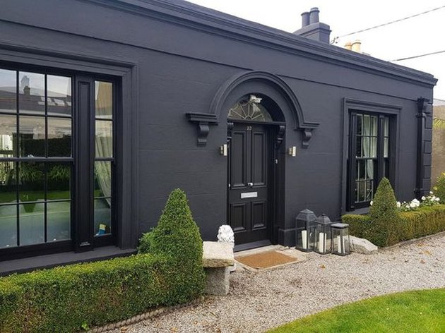 black home exterior idea with greenery