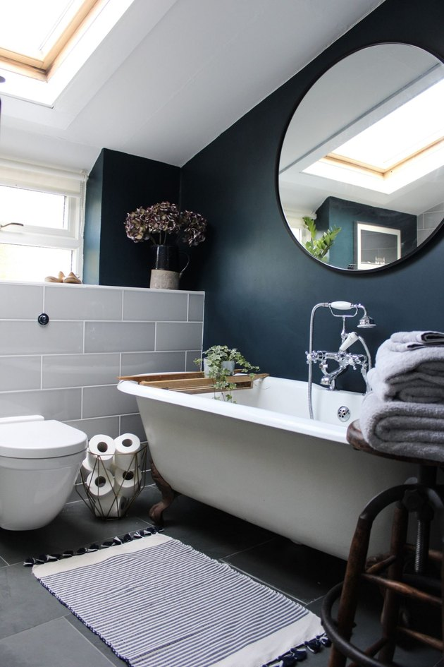 bathroom fittings with vintage-inspired tub filler and handshower with blue accent wall