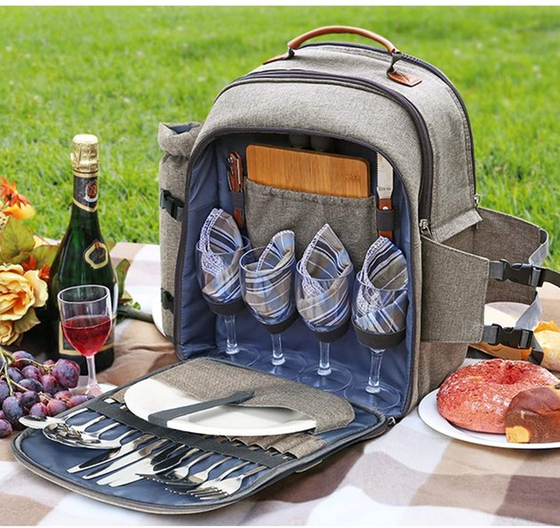 Gray backpack/picnic storage with four wine glasses, plates, and silverware
