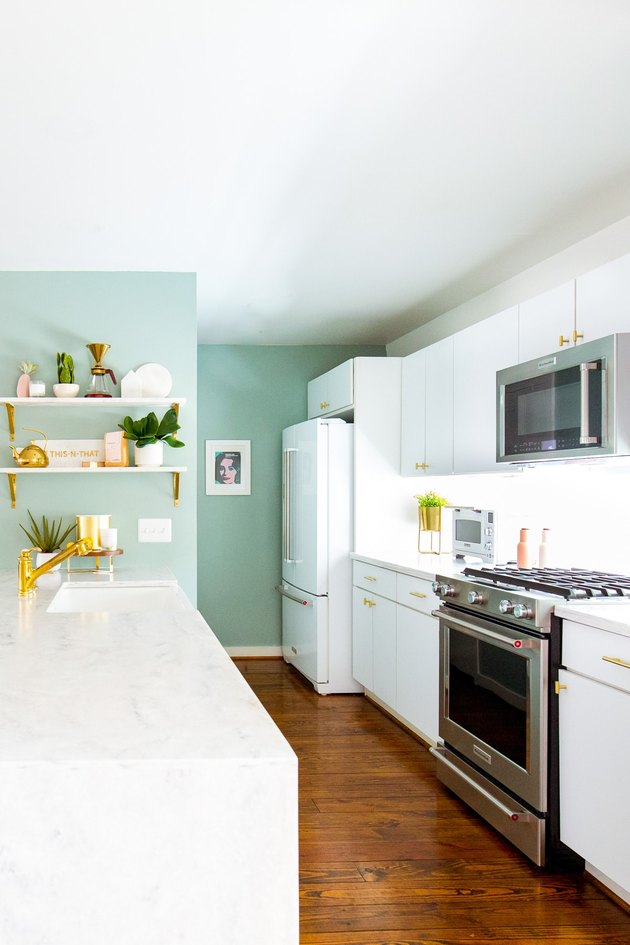 small kitchen layout idea with white cabinets and aqua walls