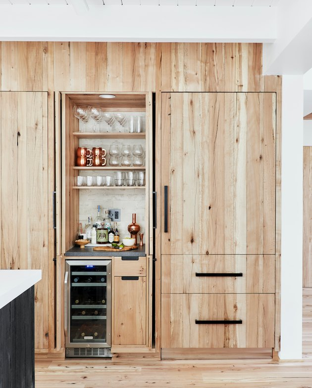 wood kitchen cabinets with black hardware