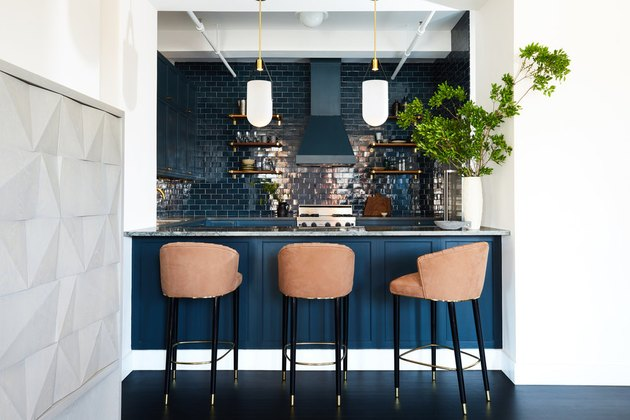 kitchen with blue cabinets and blue tile backsplash