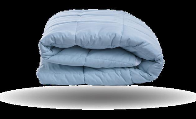 Light blue folded mattress pad