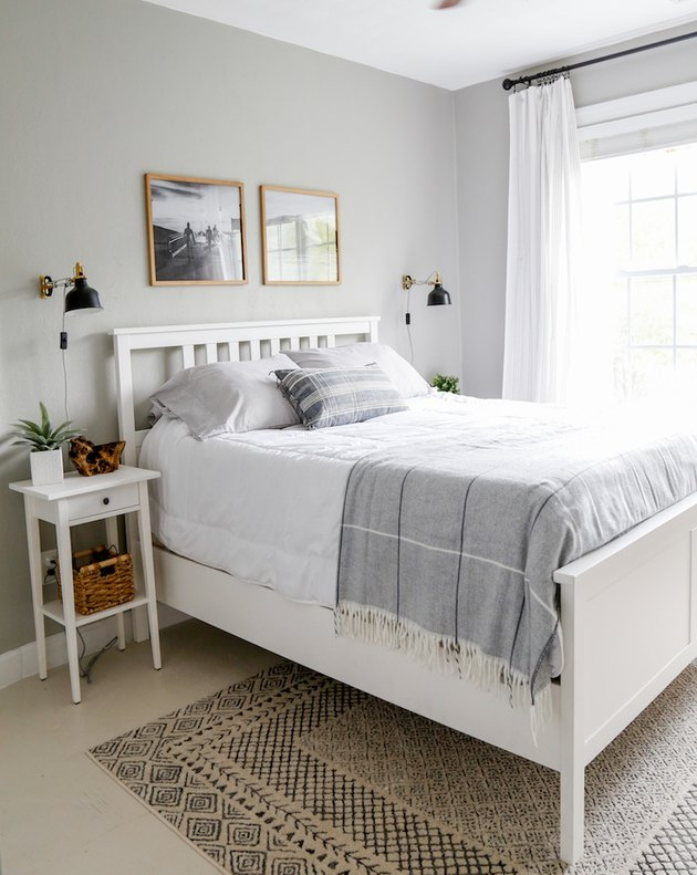 Neutral coastal bedding idea with gray and white bedding and gray walls