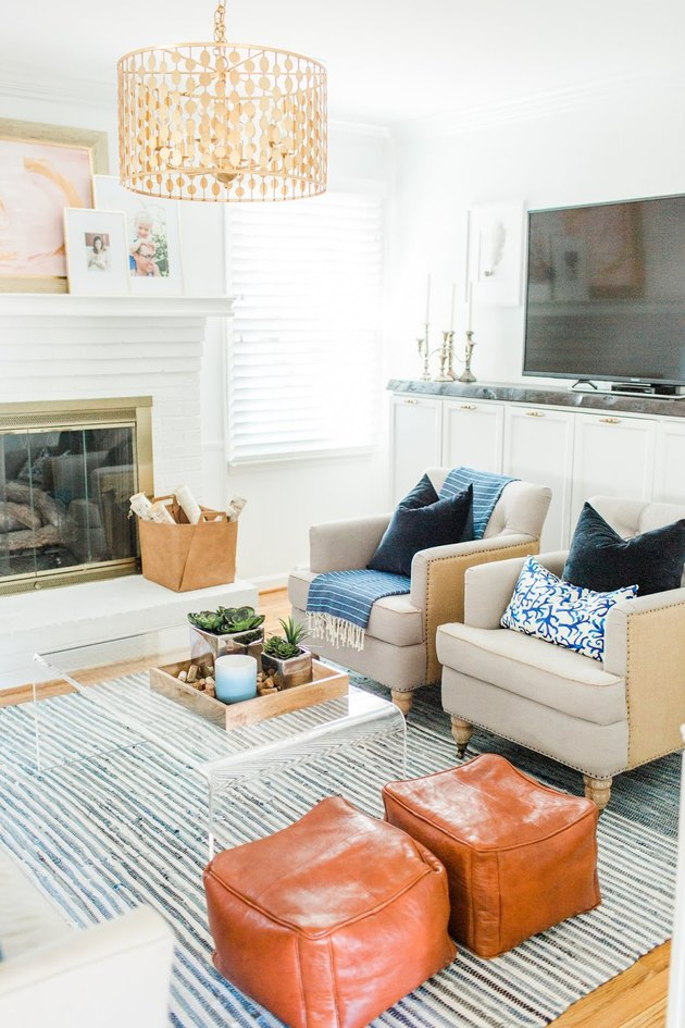 Coastal paint colors in living room with boho decor accents and white walls