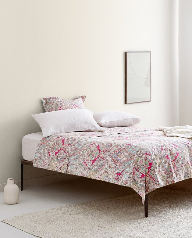 bed with a paisley duvet