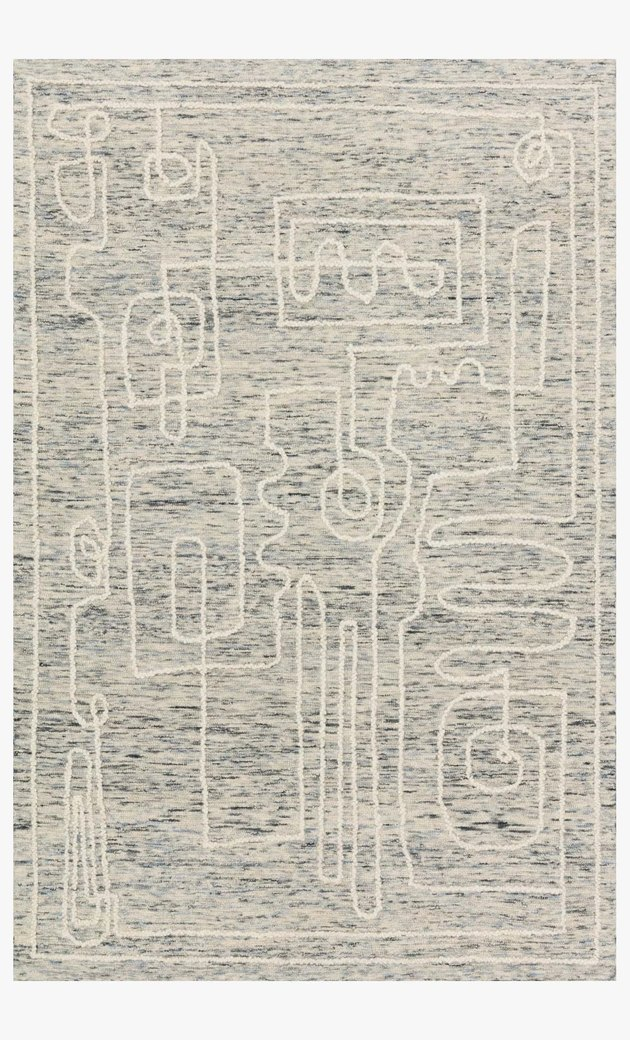 white rug with doodles