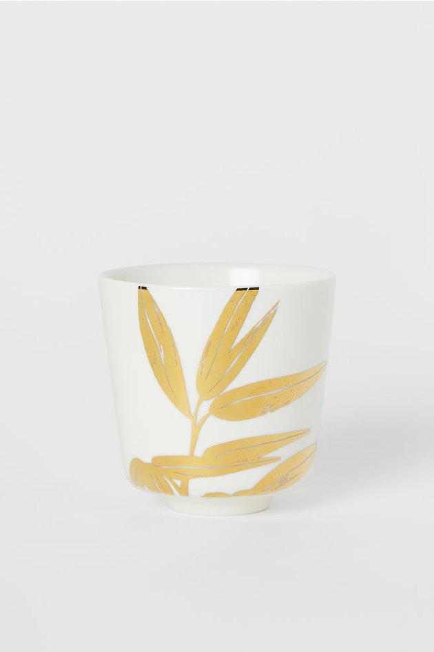 white and gold porcelain mug