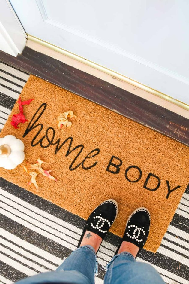 Homebody fall doormat with striped rug and sparkly shoes