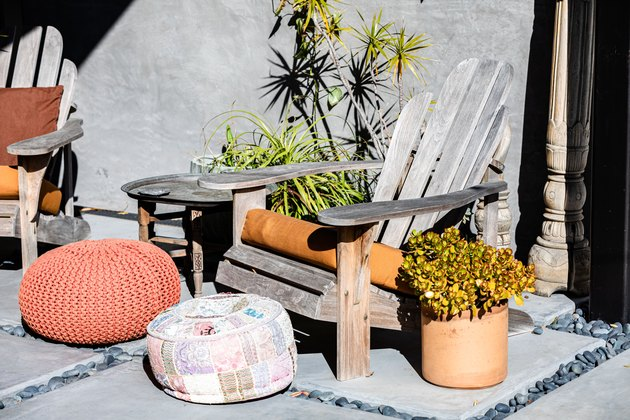 Adirondack Chairs with potted plant and footstool