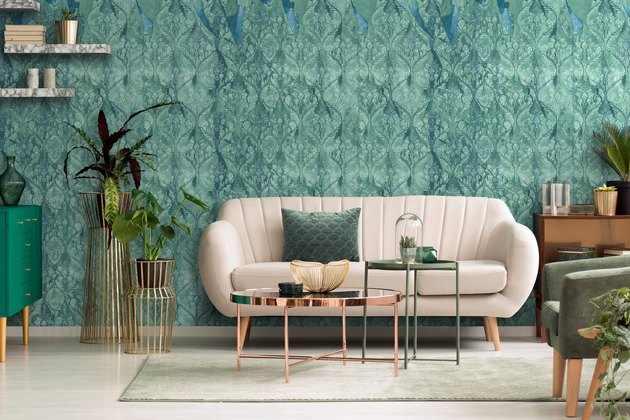 living room with green damask wallpaper