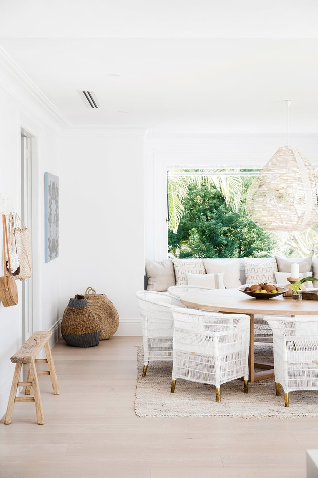 white coastal farmhouse dining room with rattan dining chairs