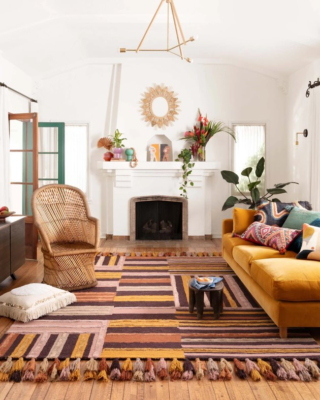 living room with orange brown pink striped rug