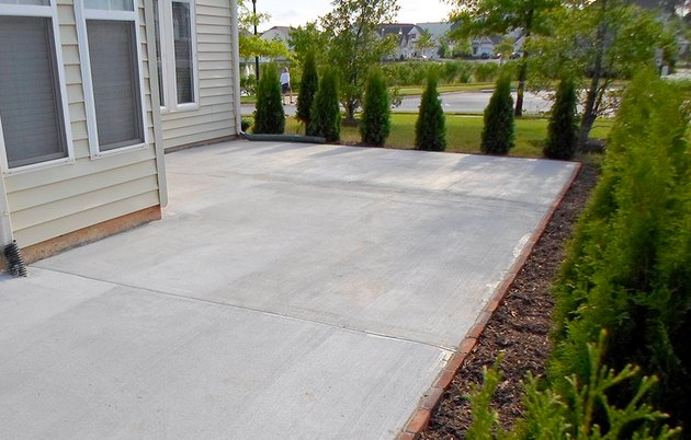 Clean, resurfaced concrete patio.